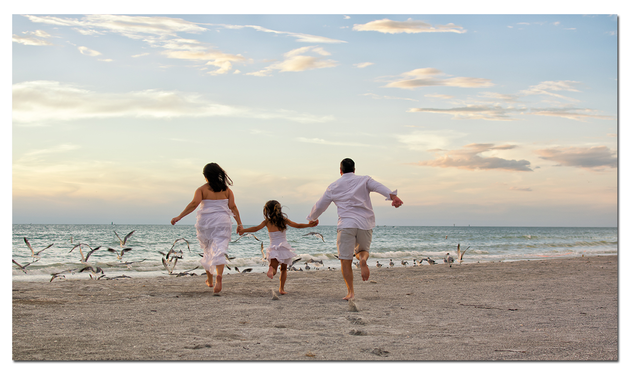 picture of family running at clearwater beach - clearwater beach photographer